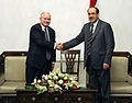 Defense.gov News Photo 110407-F-DQ383-020 - Secretary of Defense Robert M. Gates poses for a photo and shakes hands with Iraqi Prime Minister Maliki during a trip to Baghdad Iraq on April.jpg