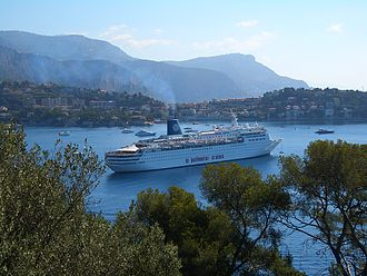 Pullmantur Cruises - SS Sky Wonder in the harbor of Villefranche-sur-Mer, in the blue-funneled Pullmantur colours.