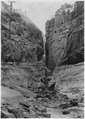Echo Canyon on East Rim Trail. Pot holes along stream bed. Horse back party. - NARA - 520446.tif