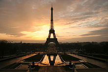 The Eiffel Tower silhouetted by a sunrise.