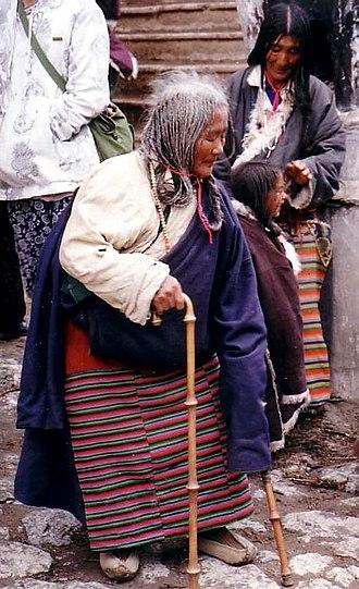 Buddhist pilgrimage - Elderly pilgrim, Tsurphu Gompa, Tibet, 1993