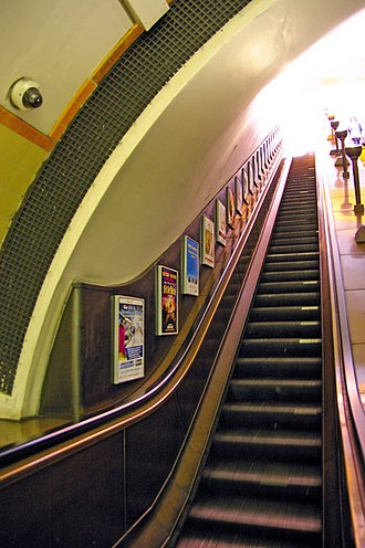 Southgate tube station - Escalators with uplighters at Southgate station