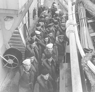 History of the United States Coast Guard - USCGC Escanaba crewmembers on deck early in World War II