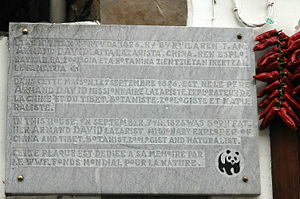 Armand David - Multilingual plate at his birthplace from the World Wildlife Fund.