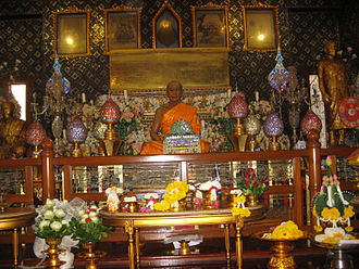 Luang Pu Sodh Candasaro - Statue of Luang Pu Sodh Candasaro at Wat Paknam Bhasicharoen, placed above his coffin.