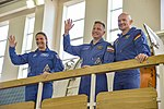 Expedition 56 prime crew members wave to reporters in Star City, Russia.jpg