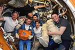 Expedition 57 crew gathers inside the Pirs airlock.jpg
