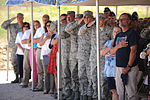 Family members, friends, and colleagues pay homage to the airmen of the North Carolina Air National Guard C-130 Modular Airborne Fire Fighting System 7 aircraft that crashed while supporting the White Draw Fire 130701-Z-RN486-003.jpg