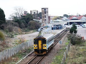 Felixstowe railway station - A train for Ipswich leaves the one remaining and shortened platform, with the old station buildings in the background.