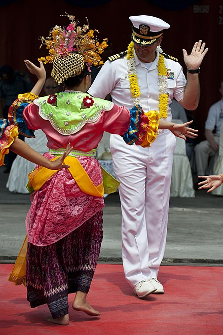 A Betawi dancer welcomes a U.S. Navy officer
