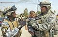 Flickr - The U.S. Army - Iraqi child wearing a NP uniform.jpg
