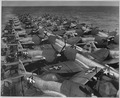 Flight Deck, USS CASABLANCA. Flight deck load, aircraft, P-47NE5, aft. Planes loaded at Naval Air Station in Alameda... - NARA - 520581.tif