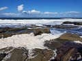 Foam washed up by sea at Maroochydore beach.jpg
