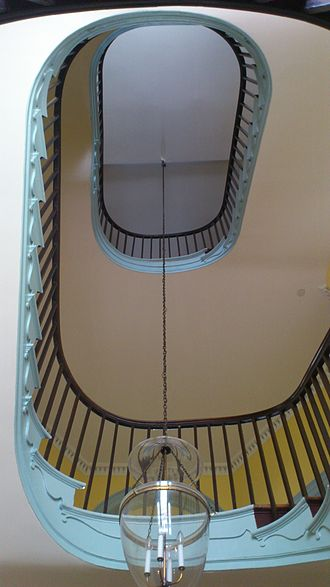 The Octagon House - Formal oval curved stairway