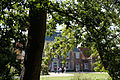 Forty Hall through an oak, Enfield, London, England.jpg