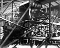 Fred J Wiseman piloting the first airplane (biplane) to land at the first air show at Olympia, held on the newly-built port fill (CURTIS 1244).jpeg