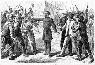 Freedmen's Bureau - A Bureau agent stands between armed groups of whites and freedmen in this 1868 drawing from Harper's Weekly.