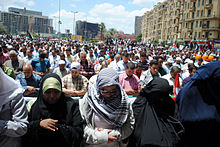 Friday prayer in Tahrir (Women Ahead of men).jpg