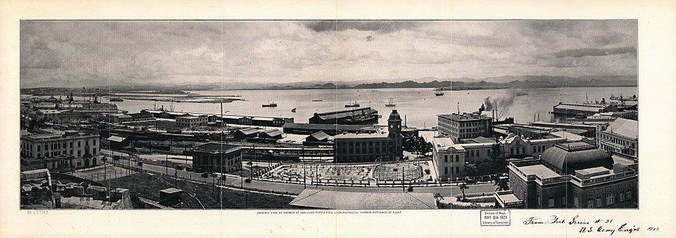 General view of harbor at San Juan, Puerto Rico looking South to San Juan Bay, 1927. The clock tower building at center was the San Juan Rail Terminal.