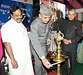 Ghulam Nabi Azad lighting the lamp at the closing function of Red Ribbon Express-III, in New Delhi. The Union Minister for Railways, Shri Pawan Kumar Bansal and the Minister of State for Health and Family Welfare.jpg