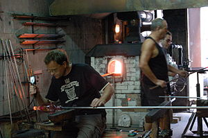 Artisan - Glassblowing artisans at work in a crystal glass workshop