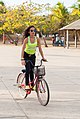 Girl walking bike.jpg