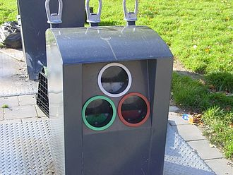 Recycling by material - An American public glass waste collection point for separating clear, green and amber glass