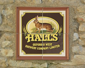 Great Haseley - The Plough Inn: tiled plaque of the now-defunct Halls Brewery