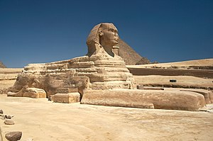Sphinx - The Great Sphinx of Giza, with the Pyramid of Khufu in the background