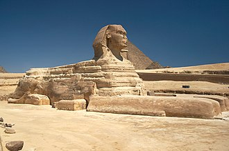 Sphinx - The Great Sphinx of Giza, with the Great Pyramid in the background.