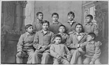 black & white photo of American Indian children in cadet uniforms at Carlisle Indian School