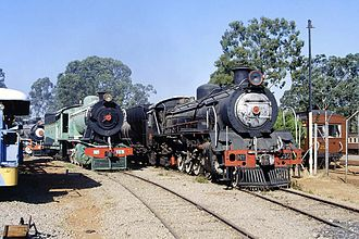 National Railways of Zimbabwe - Steam locomotives of different classes at the museum area (1990)