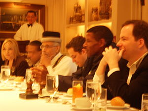 Ephraim Isaac - During a breakfast meeting (seated with hat) along with Haile Gebreselassie (second from right)