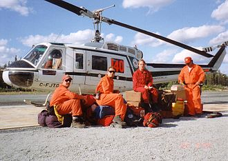 Bell 204/205 - A Bell 205A-1 with its helitack firefighting crew with the Ontario Ministry of Natural Resources in 1995
