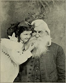 Little white girl with old bearded white man, in an affectionate embrace.