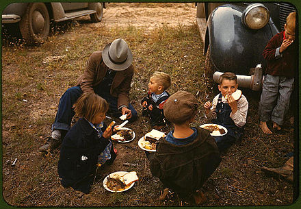 Homesteader and his children in Pie Town, New Mexico, 1940 Homesteader and his children eating barbeque at the New Mexico Fair. Pie Town, New Mexico, October 1940.jpg