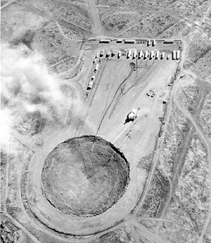 Subsidence crater - Post-shot subsidence crater and Huron King test chamber, which was less than 20 kilotons (1980)