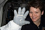 ISS-59 Anne McClain with a spacesuit glove.jpg