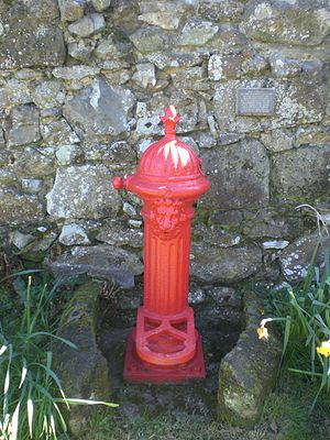 Whitwell, Isle of Wight - One of six red iron water pumps in the village.