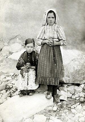 Sister Lúcia - Lúcia dos Santos (standing) with her cousin, Jacinta Marto, 1917