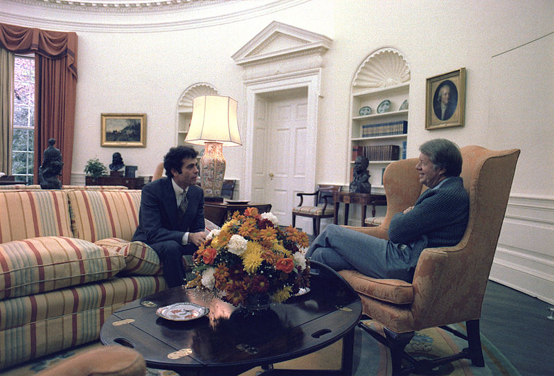 Jimmy Carter meets with Jack Watson, cabinet secretary, in the Oval Office - NARA - 176952.jpg