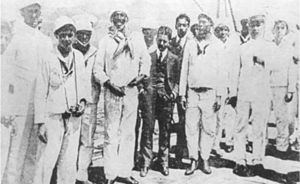 Revolt of the Lash - The leader of the Revolt of the Lash, João Cândido Felisberto (front row, directly to the left of the man in the dark suit), with reporters, officers and sailors on board Minas Geraes on 26 November 1910.