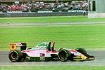 Johnny Herbert - Lotus 107 celebrates finishing fourth at the 1993 British Grand Prix (32843970584).jpg
