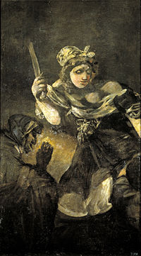 A buxom woman looms out the dark background, nonchalantly holding a short, blunt sword in her right hand. A grotesque servant woman crouches to the left of the image. The head of Holofernes is not visible.