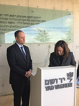 Kamala Harris signing the guest book at Yad Vashem with her husband, Doug24830055418 5323ea6526 h.jpg