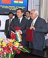 Kapil Sibal and his Chinese counterpart, Mr. Xu Guanhua shaking hands after signing an MoU on cooperation in the field of science and technology in Beijing on September 07, 2006.jpg