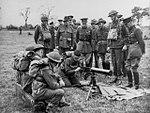 King George VI watching an Australian soldier assemble a machine gun.JPG