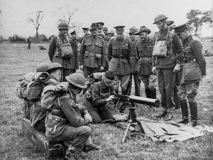 Second Australian Imperial Force in the United Kingdom - King George VI watching a blindfolded Australian soldier assemble a machine gun