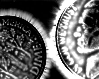 Kirlian photography - Kirlian photo of two coins