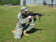 LSAT LMG used by an US Army soldier